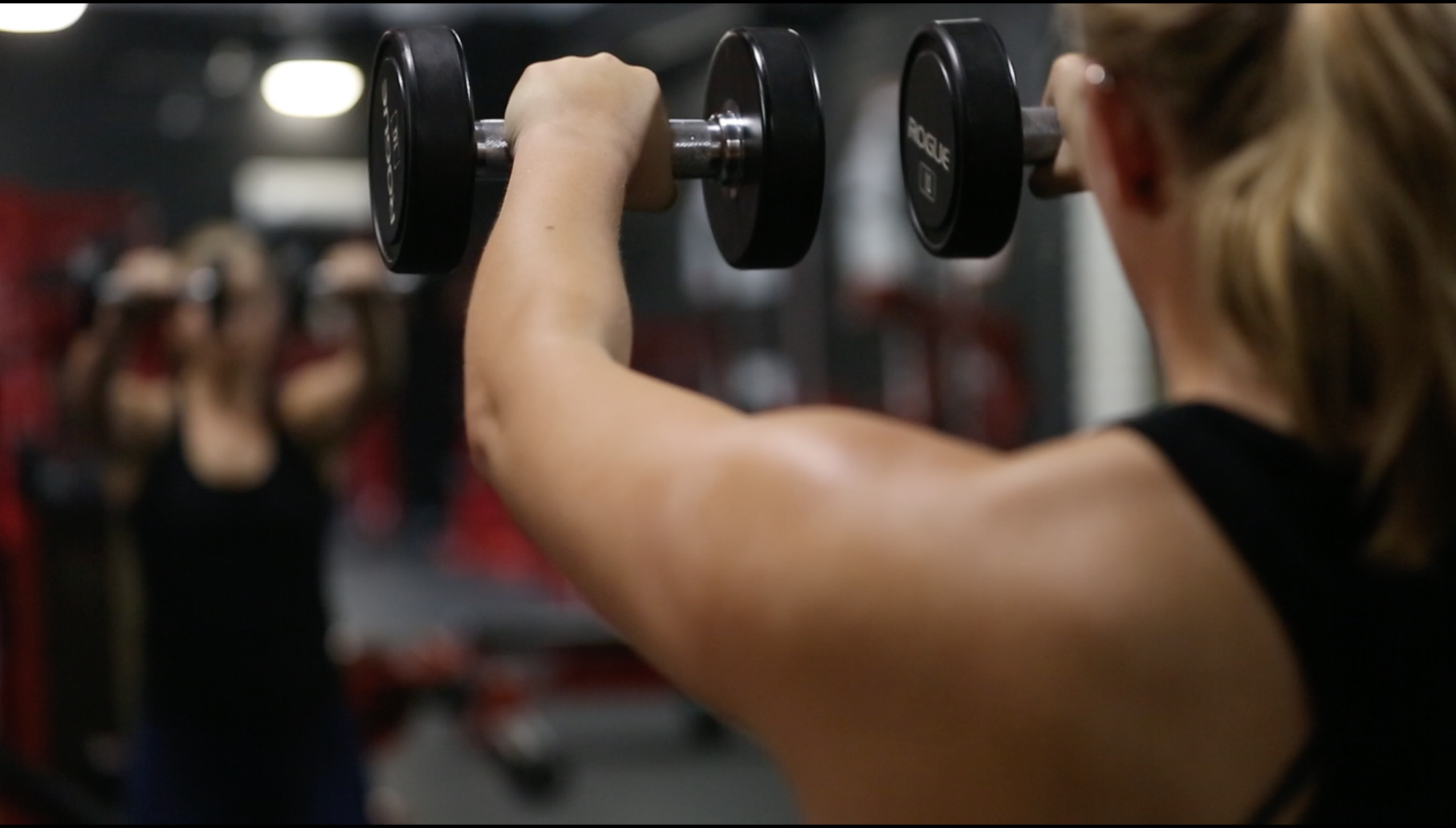 how to stay motivated front raise with dumbbells
